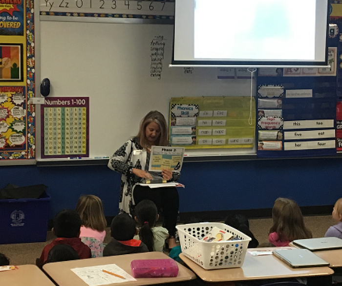 Kristi McCullough from Smekens Education working with Brown Bear 1st Graders!